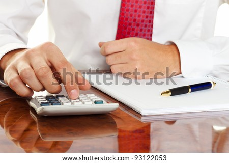 businessman with a calculator. calculation of costs, revenue, balance sheet - stock photo