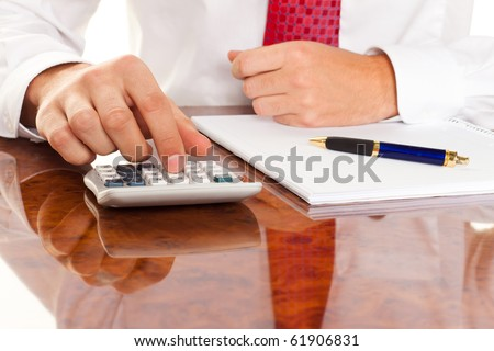 Businessman with a calculator. Calculation of costs, revenues, balance sheet - stock photo
