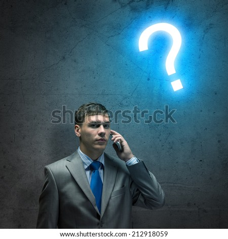 businessman with a cell phone, looking at the camera