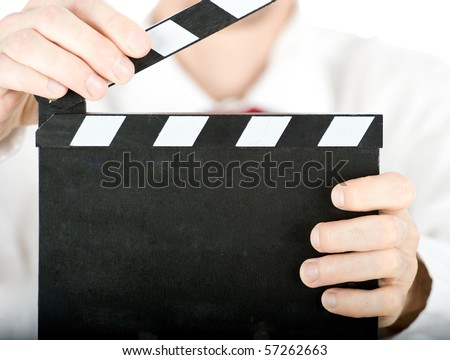 businessman with a clapperboard isolated on white background - stock photo