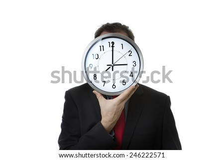 Businessman with a clock covering his face