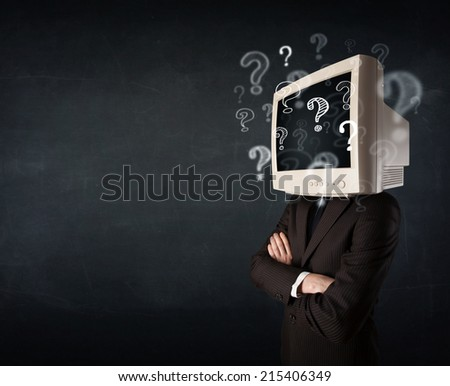 Businessman with a computer monitor head and question marks - stock photo