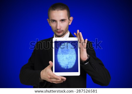 Businessman with a computer tablet - stock photo