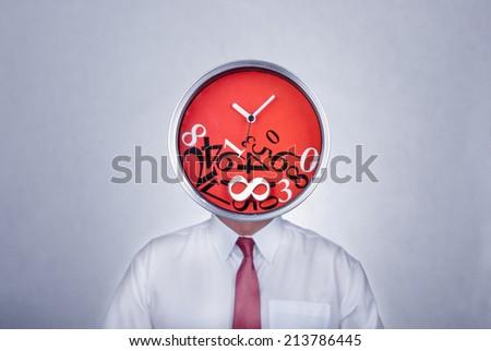 Businessman with a creative clock which imitates his head. Bad organization and time management concept. - stock photo