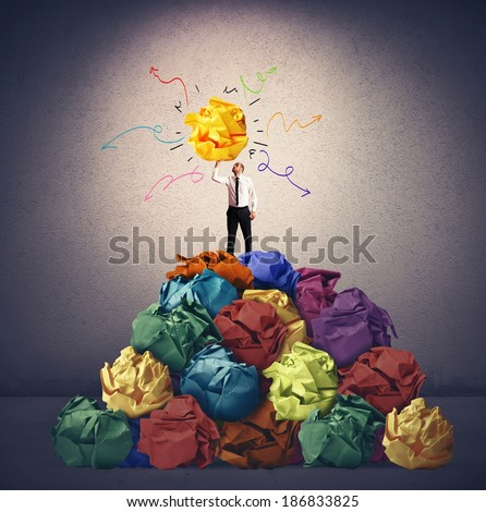 Businessman with a creative idea in hand - stock photo