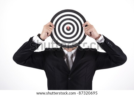 Businessman with a dart in bull's eye - stock photo