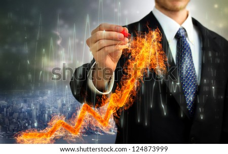 Businessman with a Flaming arrow indicating growth - stock photo