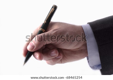 Businessman with a grey suit and blue shirt holding a pen to sign a contract