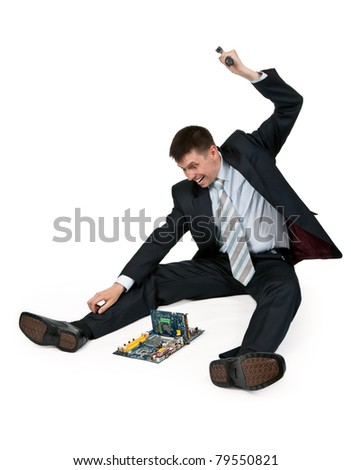 businessman with a hammer breaking a motherboard - stock photo