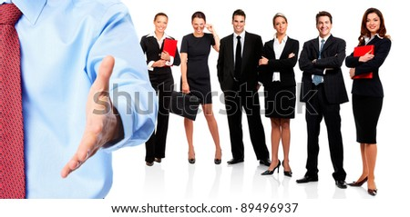 Businessman with a handshake and group of business people. Business team. Isolated over white background.