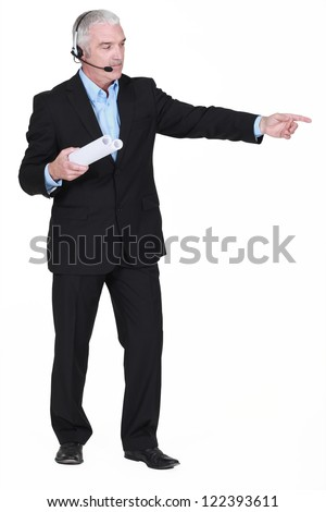 Businessman with a headset and plans - stock photo