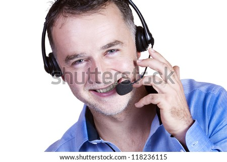 Businessman with a headset calling cheerfully. - stock photo