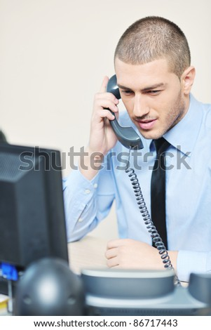 businessman with a headset portrait at bright call center helpdesk support office - stock photo