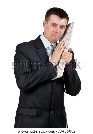 Businessman with a keyboard at the head isolated on a white background
