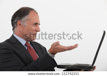 Businessman with a laptop - stock photo