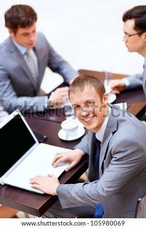 Businessman with a laptop at the table - stock photo