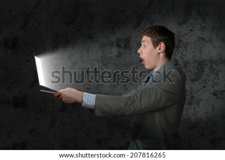 businessman with a laptop, the light on the face from the screen