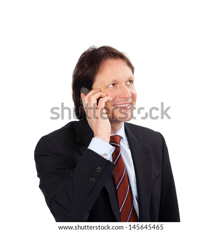 Businessman with a mobile phone smiling as he listens to the conversation isolated on white - stock photo
