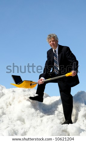 Businessman with a notebook on shovel - stock photo