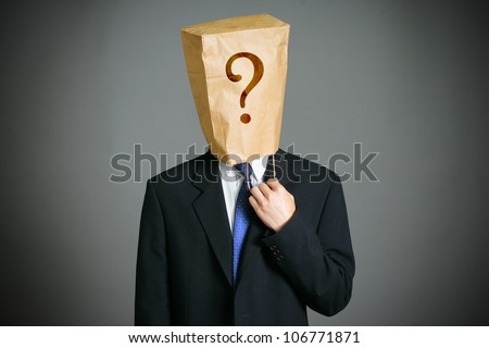 Businessman with a paper bag  on head - stock photo