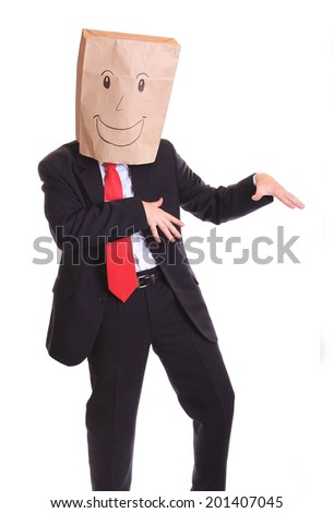 Businessman with a paper bag on head dancing - stock photo
