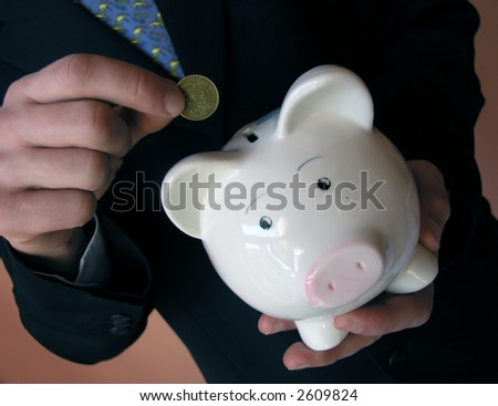 Businessman with a piggy bank. - stock photo