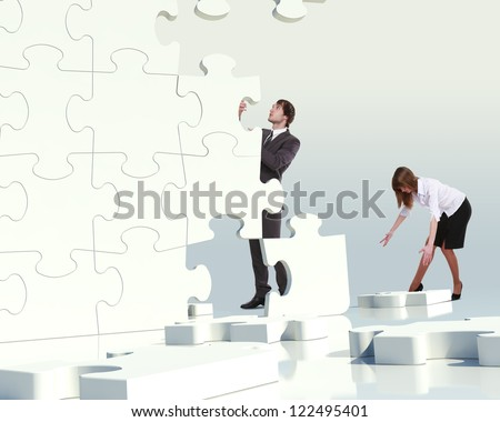Businessman with a puzzle pieces on the background - stock photo