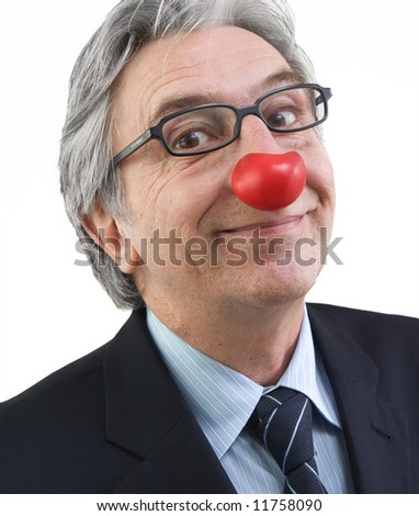 Businessman with a red nose - stock photo