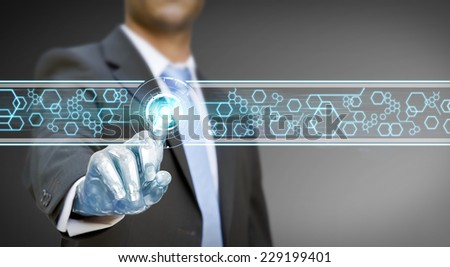 Businessman with a robot hand using a digital interface