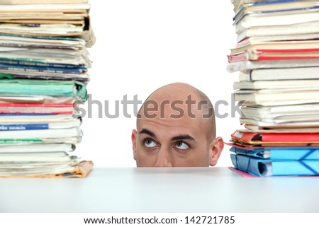 Businessman with a stack of paperwork - stock photo