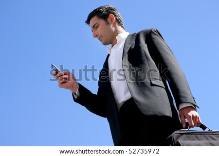 Businessman with a suitcase and a phone