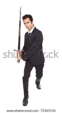 Businessman with a sword in an attacking position - stock photo