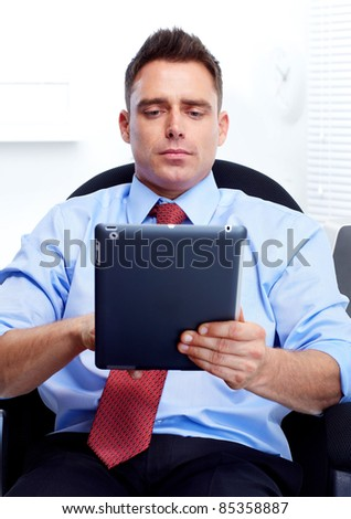 businessman with a tablet computer at the office - stock photo