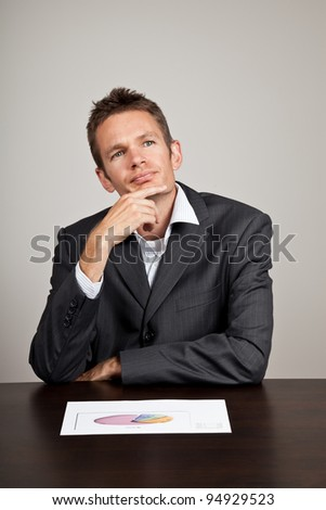 Businessman with a thoughtful expression on his face - stock photo