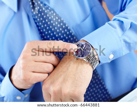 Businessman with a watch - stock photo