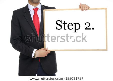 Businessman with a white board step 2. - stock photo