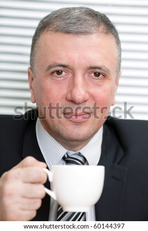 Businessman with a white cup - stock photo