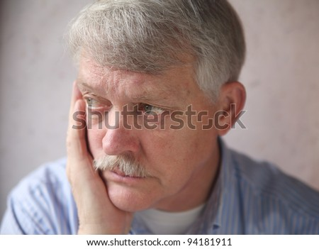 businessman with a worried, anxious expression - stock photo