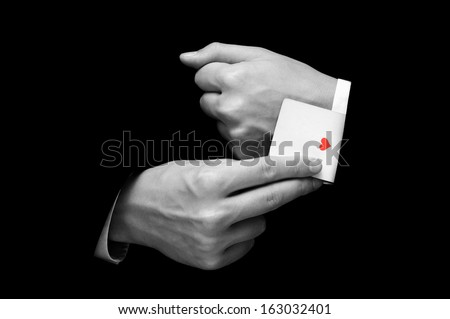 Businessman with ace card hidden under sleeve isolated on black - stock photo