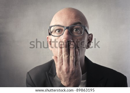 Businessman with afraid expression - stock photo