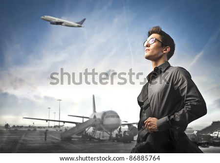 Businessman with airport in the background - stock photo