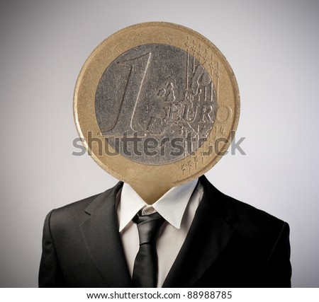 Businessman with an euro coin instead of his head - stock photo