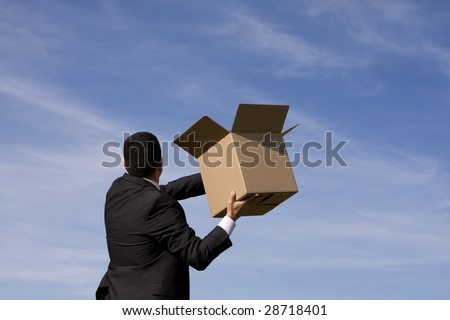 businessman with an open box to the sky - stock photo
