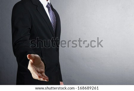 businessman with an open hand ready to seal  - stock photo