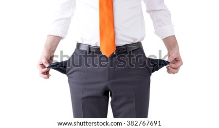 businessman with an orange tie turning his empty pockets inside out. Front view, no head. Isolated. Concept of bankruptcy. - stock photo