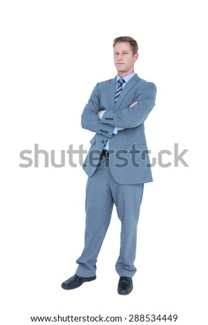 Businessman with arms crossed against a white background