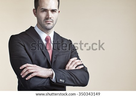 Businessman with arms crossed isolated - stock photo