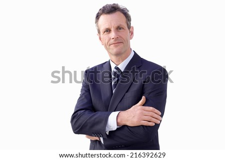 Businessman with arms crossed, smiling, portrait, cut out - stock photo