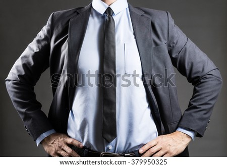 Businessman with arms on waist