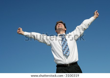 Businessman with Arms Outstretched - stock photo